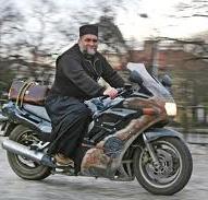 Протодяконът често може да се види и на мотоциклета